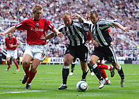 Photo: Back Page Images. 25/09/2004.<br /> Barclays Premiership. Newcastle United v W.B.A.<br /> Alan Shearer and Lee Bowyer cant decide whos going to shoot as Martin Albrechtsen has to fight them off.