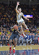 Keith Williams #2 of the Cincinnati Bearcats drives to the basket against Erik Stevenson #10 of the Wichita State Shockers during the second half at Charles Koch Arena on February 6, 2020 in Wichita, Kansas.