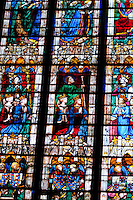 Our Lady of Chartres Cathedral, Chartres, France. The window of the Vendome Chapel - a fine late-gothic window showing the donor (Louis de Bourbon) and  his family with assorted saints witnessing the Coronation of the Virgin.