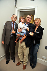 Left to right, GABRIELE AGGUGINI, EMMANUELLE AGGUGINI holding SOFIA AGGUGINI and ELISA CANOSSA at the opening of his pop up shop at 35 South Audley Street, London W1 on 19th September 2009.