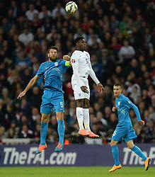 Danny Welbeck of England (Arsenal) battles for a high ball with Bostjan Cesar of Slovenia  - Photo mandatory by-line: Alex James/JMP - Mobile: 07966 386802 - 15/11/2014 - SPORT - Football - London - Wembley - England v Slovenia - EURO 2016 Qualifier