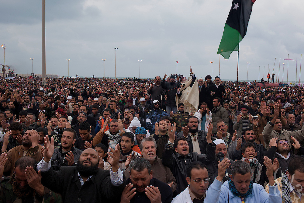 Libyan men take part in an emotional Friday prayer and a large protest February 25, 2011 in the central square of Benghazi, Libya. A crowd of at least 5,000 attended the prayers, which also included funeral prayers for three victims of the recent revolution that were laid to rest today. .Slug: Libya.Credit: Scott Nelson for the New York Times