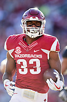FAYETTEVILLE, AR - NOVEMBER 24:  David Williams #33 of the Arkansas Razorbacks runs the ball during a game against the Missouri Tigers at Razorback Stadium on November 24, 2017 in Fayetteville, Arkansas.  The Tigers defeated the Razorbacks 48-45.  (Photo by Wesley Hitt/Getty Images) *** Local Caption *** David Williams