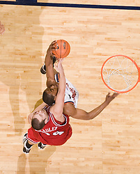 Virginia forward/center Jerome Meyinsse (55) grabs a rebound and an elbow from North Carolina State forward/center Ben McCauley (34).  The Virginia Cavaliers men's basketball team defeated the North Carolina State Wolfpack 78-60 at the John Paul Jones Arena in Charlottesville, VA on February 24, 2008.