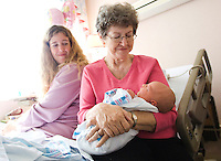 Jon M. Fletcher/The Times-Union-110207-- Nancy Lemmer holds all 9 lbs, 9 oz. of her new granddaughter, Nora Eldridge Posey, for the first time at Sarasota Memorial Hospital as her daughter Jennifer Posey looks on in Sarasota, FL, November 2, 2007.  <br /> &quot;I'm so glad I got to meet you,&quot; Nancy said to the newborn. (The Florida Times-Union, Jon M. Fletcher)
