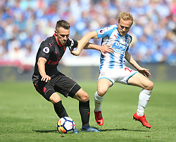 Aaron Ramsey of Arsenal (L) and Alex Pritchard of Huddersfield Town Arsenal - Mandatory by-line: Jack Phillips/JMP - 13/05/2018 - FOOTBALL - The John Smith's Stadium - Huddersfield, England - Huddersfield Town v Arsenal - English Premier League