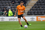 Hull City player Angus MacDonald (15) warms up before the EFL Sky Bet Championship match between Hull City and Middlesbrough at the KCOM Stadium, Kingston upon Hull, England on 2 July 2020.