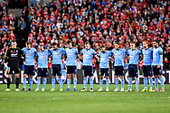 May 24, 2017: Sydney FC stand for one minute silence in respect of the terrorist attacks in Manchester at the soccer match, between English Premiere League team Liverpool FC and Sydney FC, played at ANZ Stadium in Sydney, NSW Australia.