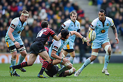 Northampton Flanker (#6) Tom Wood offloads to Northampton Lock (#5) Courtney Lawes as he is tackled by Saracens Scrum-Half (#9) Neil de Kock and Lock (#5) Mouritz Botha during the first half of the match - Photo mandatory by-line: Rogan Thomson/JMP - Tel: Mobile: 07966 386802 30/12/2012 - SPORT - RUGBY - stadiummk - Milton Keynes. Saracens v Northampton Saints - Aviva Premiership.