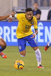 Sep 9, 2014; East Rutherford, NJ, USA; Brazil forward Neymar (10) runs with the ball during the first half at MetLife Stadium.