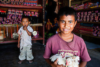 Two boys in a fabric shop, Dili, East Timor