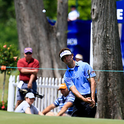2009 April 26: Michael Letzig of Kansas City, MO chips onto the green at the 17th hole during the final round of the Zurich Classic of New Orleans PGA Tour golf tournament played at TPC Louisiana in Avondale, Louisiana.