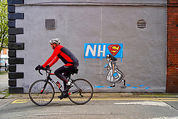 © Licensed to London News Pictures. 03/04/2020. Pontefract, UK. A cyclist rides past a new mural by local artist Rachel List painted in support of the NHS on the wall of the Horse Vaults pub in Pontefract, West Yorkshire. Photo credit: Scott Merrylees/LNP Scott Merrylees/LNP