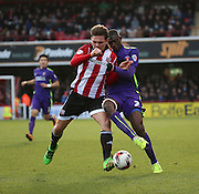 Charlton Athletic striker, Yaya Sanogo (25) battling for ball with Brentford defender, Harlee Dean (6) during the Sky Bet Championship match between Brentford and Charlton Athletic at Griffin Park, London, England on 5 March 2016. Photo by Matthew Redman.