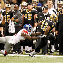 November 28, 2011; New Orleans, LA, USA; New Orleans Saints running back Darren Sproles (43) slips away from a tackle by New York Giants safety Kenny Phillips (21) during the second quarter of a game at the Mercedes-Benz Superdome. The Saints defeated the Giants 49-24. Mandatory Credit: Derick E. Hingle-US PRESSWIRE