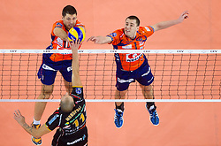 Borislav Petrovic of ACH and Andrej Flajs of ACH vs Natale Monopoli of Macerata  during volleyball match between ACH Volley and Lube Banca Marche Macerata (ITA) in 5th Leg of Pool D of 2013 CEV Champions League on December 5, 2012 in Arena Stozice, Ljubljana, Slovenia. ACH defeated Macerata 3-1. (Photo By Vid Ponikvar / Sportida)