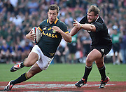 JOHANNESBURG, South Africa, 04 October 2014 : Handré Pollard of the Springboks is too quick for Joe Moody of the All Blacks in scoring his first try during the Castle Lager Rugby Championship test match between SOUTH AFRICA and NEW ZEALAND at ELLIS PARK in Johannesburg, South Africa on 04 October 2014. <br /> The Springboks won 27-25 but the All Blacks successfully defended the 2014 Championship trophy.<br /> <br /> © Anton de Villiers / SASPA