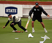 Matthew Bell and John Bracewell try to stop paperwork from blowing away.<br /> National Bank Test Match Series, New Zealand v England, Black Caps Nets Practice. Allied Prime Basin Reserve, New Zealand. Tuesday, 11 March 2008. Photo: Dave Lintott/PHOTOSPORT