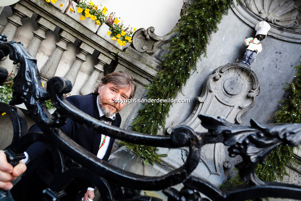 Brussels, Belgium, 2012 19 December. Belgian chocolate brand Leonidas starts celebrating its 100 years exitence in 2013. At the famous Belgian medieval statue Manneken Pis (peeing man) people gathered today.This man behind the gate is responsable for the peeing of manneken piss during the event.