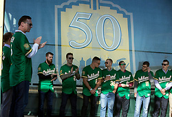 A's manager Bob Melvin, left, and members of the 2018 team are introduced during Oakland Athletics FanFest at Jack London Square on Saturday, Jan. 27, 2018 in Oakland, Calif. (D. Ross Cameron/SF Chronicle)
