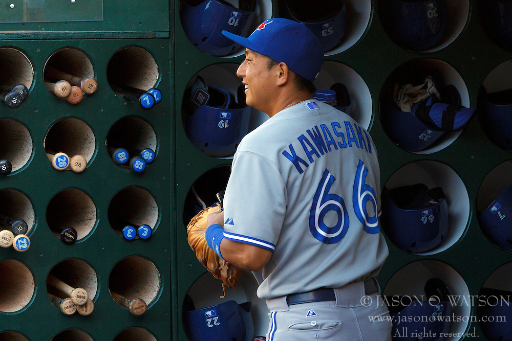 OAKLAND, CA - JULY 05:  Munenori Kawasaki #66 of the Toronto Blue Jays stands in the dugout before the game against the Oakland Athletics at O.co Coliseum on July 5, 2014 in Oakland, California. The Oakland Athletics defeated the Toronto Blue Jays 5-1.  (Photo by Jason O. Watson/Getty Images) *** Local Caption *** Munenori Kawasaki