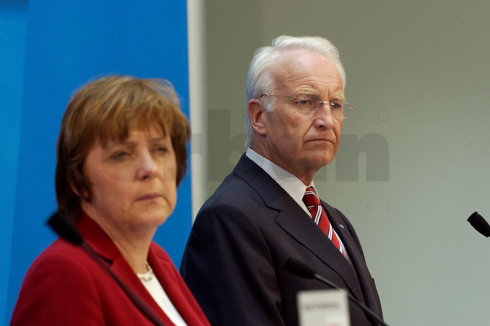 02 APR 2004, BERLIN/GERMANY:<br /> Angela Merkel (L), CDU Bundesvorsitzende, und Edmund Stoiber (R), CSU, Ministerpraesident Bayern, waehrend einem Pressestatement zu dem vorangegangenem europapolitischen Spitzengespraech von CDU und CSU, Konrad-Adenauer-Haus<br /> IMAGE: 20040402-02-013<br /> KEYWORDS: Ministerpr&auml;sident, CDU Bundesgeschaeftsstelle