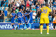 Gillingham FC forward Mikael Ndjoli  (10) scores a penalty goal (2-0) and celebrates with team mates during the EFL Sky Bet League 1 match between Gillingham and Wycombe Wanderers at the MEMS Priestfield Stadium, Gillingham, England on 14 September 2019.
