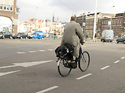 white collar worker riding to work Amsterdam Holland