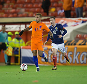 9th November 2017, Pittodrie Stadium, Aberdeen, Scotland; International Football Friendly, Scotland versus Netherlands; Holland's Memphis Depay and Scotland's Callum McGregor