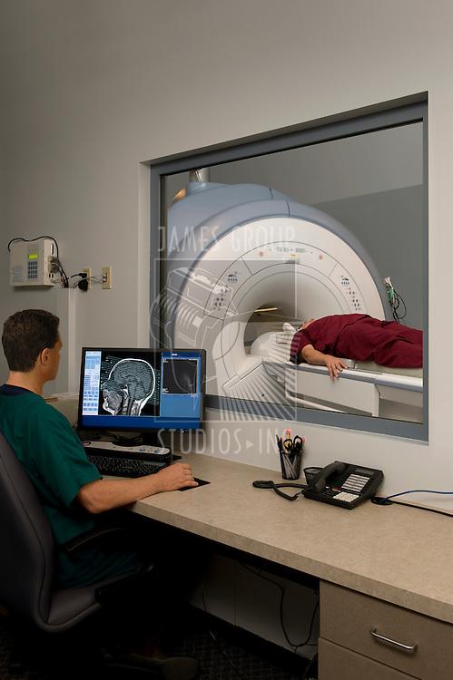 Technician monitoring an MRI scan