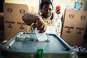 A woman casts her ballot at a polling station in Ghana's capital Accra during presidential and parliamentary elections on Sunday December 7, 2008.