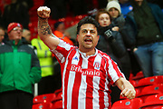 A Stoke City fan celebrates during the EFL Sky Bet Championship match between Stoke City and Derby County at the Bet365 Stadium, Stoke-on-Trent, England on 28 November 2018.