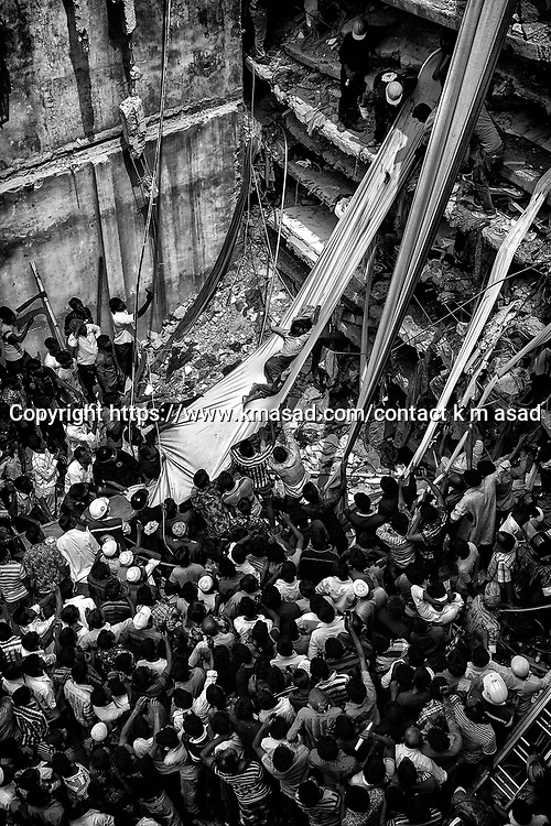 Rescue workers take part in the rescue of the eight-storey building Rana Plaza which collapsed at Savar, outside Dhaka, Bangladesh. Reports state that 1130 workers died and nearly 2500 were rescued alive after the eight-story building Rana Plaza that housed mostly garment factories collapsed on 24 April 2013.