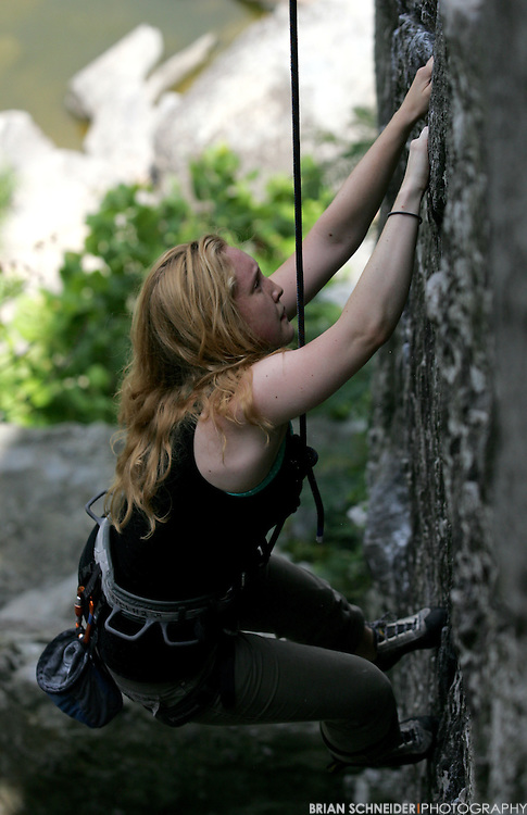 July 18, 2010; Baltimore, MD, USA; Towson University students rock climbing at Great Falls National Park in Virginia. Mandatory Credit: Brian Schneider-www.ebrianschneider.com