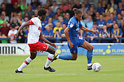 AFC Wimbledon defender Nesta Guinness-Walker (18) dribbling during the EFL Sky Bet League 1 match between AFC Wimbledon and Rotherham United at the Cherry Red Records Stadium, Kingston, England on 3 August 2019.