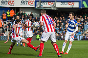 Joe Allen (Stoke) gets to the ball ahead of Josh Scowen (Queens Park Rangers) during the EFL Sky Bet Championship match between Queens Park Rangers and Stoke City at the Loftus Road Stadium, London, England on 9 March 2019.