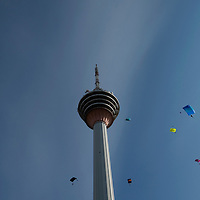 BASE jumper floats near the Kuala Lumpur Tower (421 metres) during an attempt to set a new record in 24 hours in Kuala Lumpur, Malaysia 29 October 2008. Heavy rain has foiled an attempt to rewrite the world record for endurance BASE jumping in 24 hours at the 421-metre high KL Tower. The group, comprising jumpers from Canada, China, Denmark, Holland, India, Indonesia, Ireland, Italy, Malaysia, New Zealand, Norway, Russia, Singapore, and Turkey, managed 543 jumps, 33 short of the world record of 576 as per the Guinness Book of World Records.BASE is an acronym for Building, Antennae, Span, Earth, and thus represents the fixed-objects from which BASE jumps are made.The jumper must allow a free fall of about three seconds to clear the tower-head section before deploying their chute.From a height of 300 metres, without a parachute, it takes only 10 - 12 seconds to reach the ground.