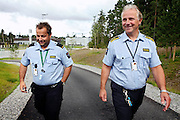 Are Høidal, (right) the director of the luxurious Halden Fengsel, (prison) is walking in the prison's yard alongside one of the guards in Halden, near Oslo, Norway.