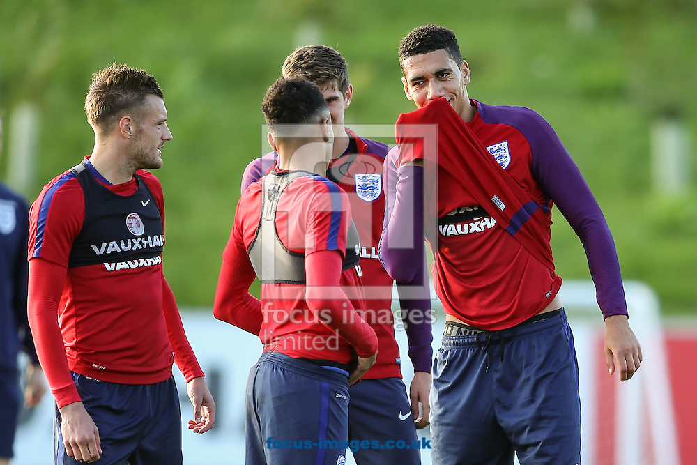 Chris Smalling (Manchester United) (right) whispers to his team mates during the England training session at St Georges Park, Burton upon Trent<br /> Picture by Andy Kearns/Focus Images Ltd 0781 864 4264<br /> 04/10/2016