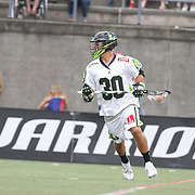 A member of the New York Lizards runs with the ball with a Warrior brand advertisement behind him during the game at Harvard Stadium on July 19, 2014 in Boston, Massachusetts. (Photo by Elan Kawesch)