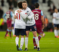 LONDON, ENGLAND - Wednesday, January 29, 2020: Liverpool's macaptain Jordan Henderson (R) embraces goal-scorer Mohamed Salah after the FA Premier League match between West Ham United FC and Liverpool FC at the London Stadium. Liverpool won 2-0.  (Pic by David Rawcliffe/Propaganda)