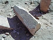 Broken stone section with Sabaic inscription