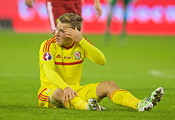 BRUSSELS, BELGIUM - Sunday, November 16, 2014: Wales' George Williams sits with a head injury as the fourth official refuses the medics permission to enter the pitch during the UEFA Euro 2016 Qualifying Group B game against Belgium at the King Baudouin [Heysel] Stadium. (Pic by David Rawcliffe/Propaganda)