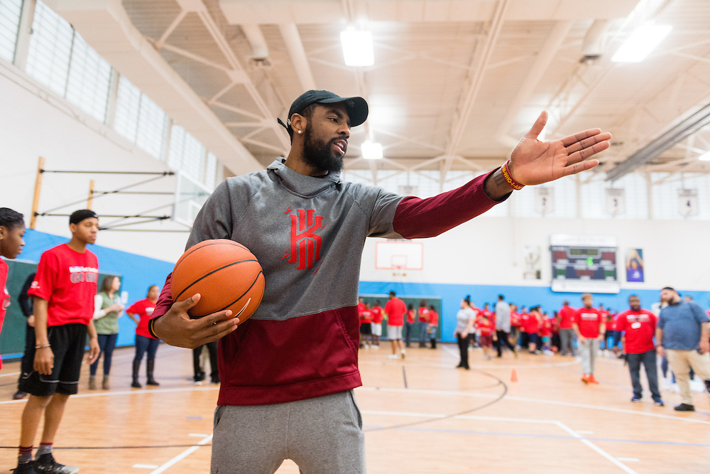 NBA star Kyrie Irving instructs Club kids during the Kids Foot Locker Fitness Challenge kickoff event at Boys & Girls Clubs of Cleveland on Friday, Jan. 20, 2017, in Cleveland. (Jason Miller/AP Images for Kids Foot Locker)