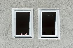20.03.2014, Salzburg, AUT, Stadtansicht Salzburg, im Bild Eine Frau geniesst mangels Balkon die Sonne am Fenster ihrer Wohnung // Cityscape of Salzburg, Austria on 2014/03/20. EXPA Pictures &copy; 2014, PhotoCredit: EXPA/ Freshfocus/ Andy Mueller<br /> <br /> *****ATTENTION - for AUT, SLO, CRO, SRB, BIH, MAZ only*****