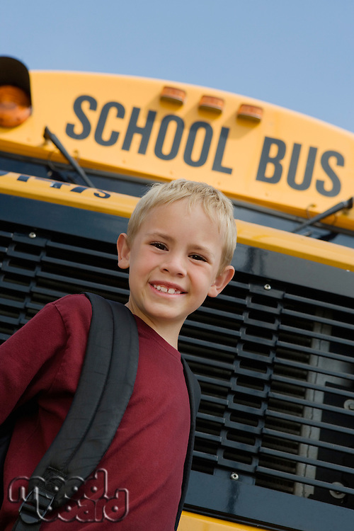 Elementary Student Standing by School Bus