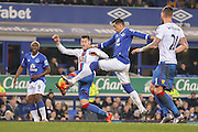 Everton defender Ramiro Funes Mori   stops Crystal Palace defender Joel Ward  getting a shot on goal during the Barclays Premier League match between Everton and Crystal Palace at Goodison Park, Liverpool, England on 7 December 2015. Photo by Simon Davies.