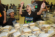 Sisters Mia and Ari Torres (L to R, 5 & 7 respectively) celebrate their team's completion of another round of bagged food rations to be shipped to Jamaica at Feed My Starving Children in Schaumburg, Illinois on Saturday, May 21st, 2011 during Nicor's 15th Volunteer Day. The company's annual event includes volunteering at events like outdoor clean ups at local social service agencies, food sorting at area pantries and energy-saving improvements at the homes of senior citizens. For additional information, visit nicor.com or contact Richard Caragol at 630-388-2686.