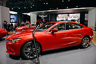 Manhattan, New York, USA. April 12, 2017.  2017 Mazda6 Grand Touring in Soul Red Metallic is on display at the New York International Auto Show, NYIAS, during the first Press Day at the Javits Center.