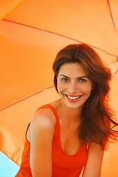 Smiling Woman Under Orange Parasol